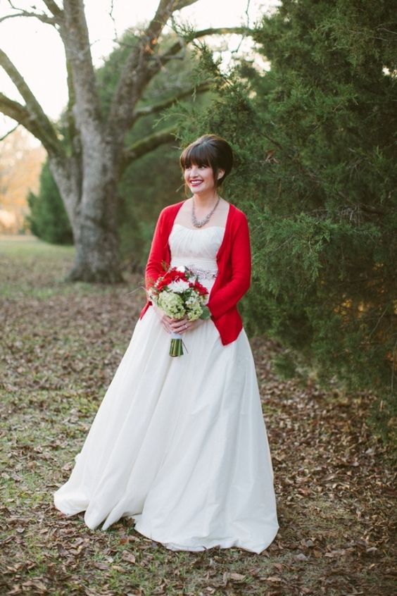 a hot red cardigan for a winter or Christmas bride is great idea to embrace the season