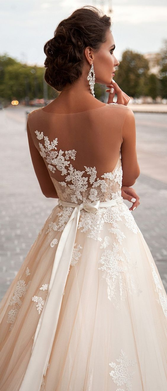 A Wedding Ballgown With Sheer Back And Lace Liques On It For Refined Look