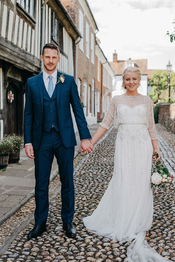 an illusion neckline wedding dress with half sleeves and beading all over