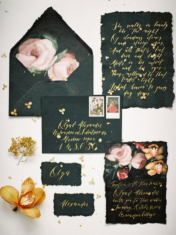 black wedding stationery with a raw edge, gold calligraphy and watercolor blooms