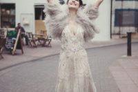 17 a beaded wedding dress with a deep V-neckline, a faux fur coverup