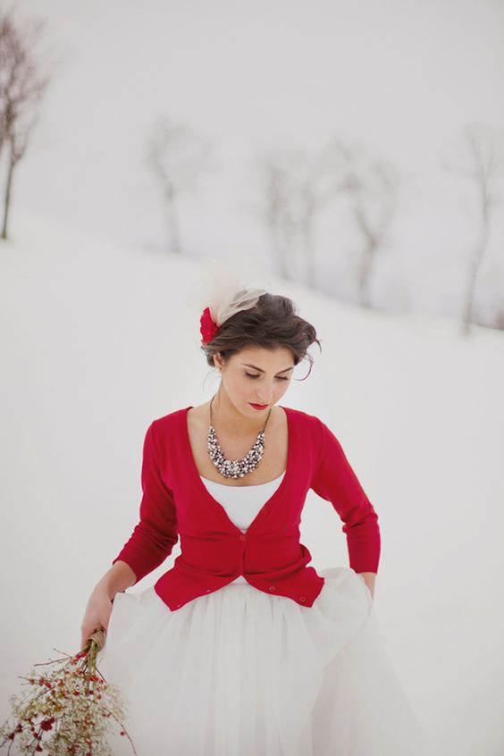 a hot red cardigan, a statement necklace and red lips are all you need to accessorize a simple wedding dress