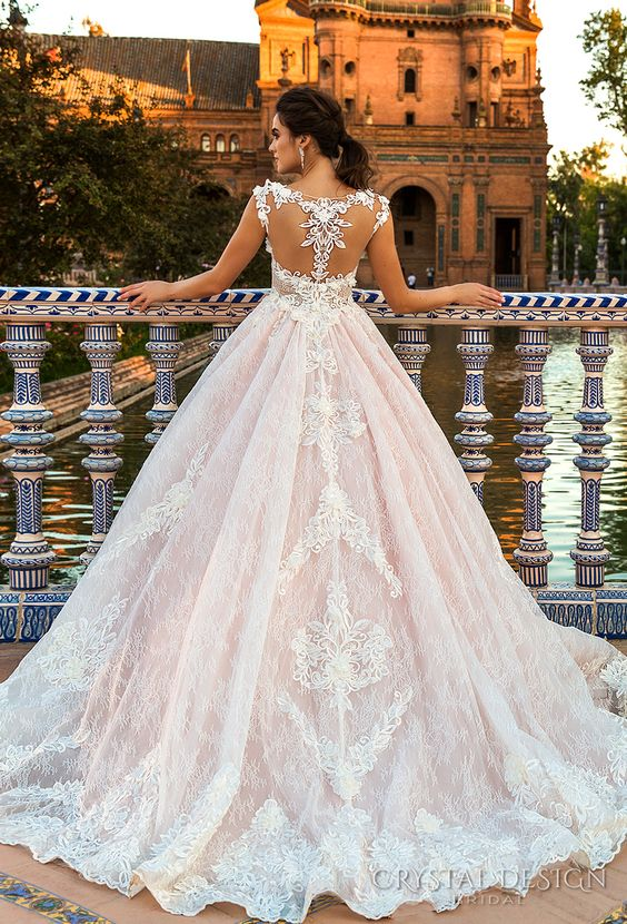 blush wedding ballgown with a lace racerback and a lace skirt