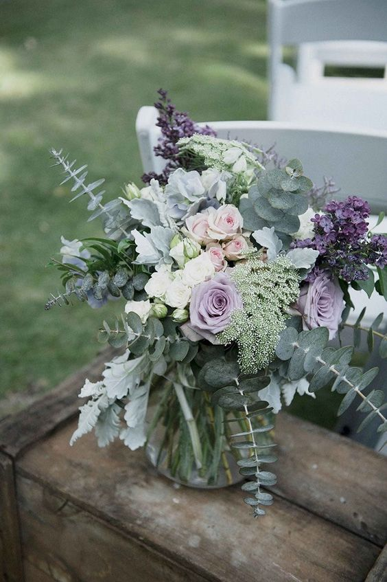 a beautiful floral arrangement with pale eucalyptus, greenery and lilac and lavender blooms
