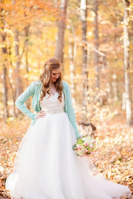 a mint cardigan over a wedding dress for a fall or spring bride