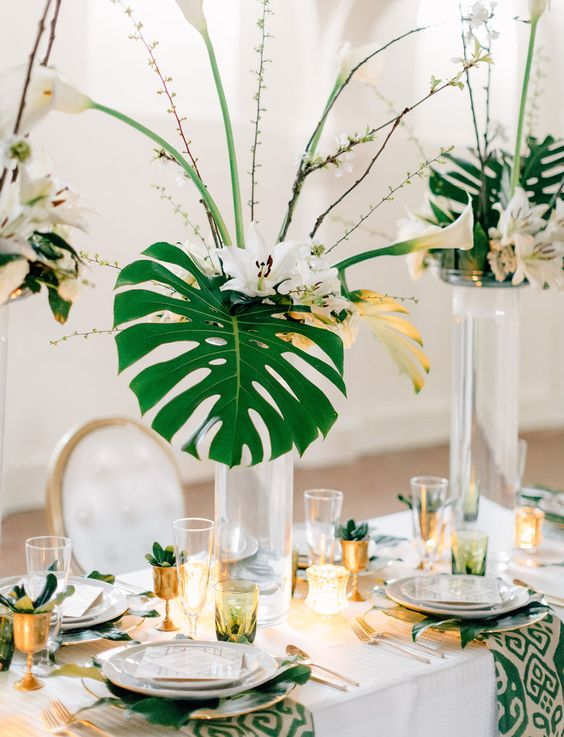 all wedding centerpieces with white callas, tropical leaves and delicate branches