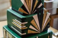 18 an emerald square wedding cake with black, white and gold glitter details