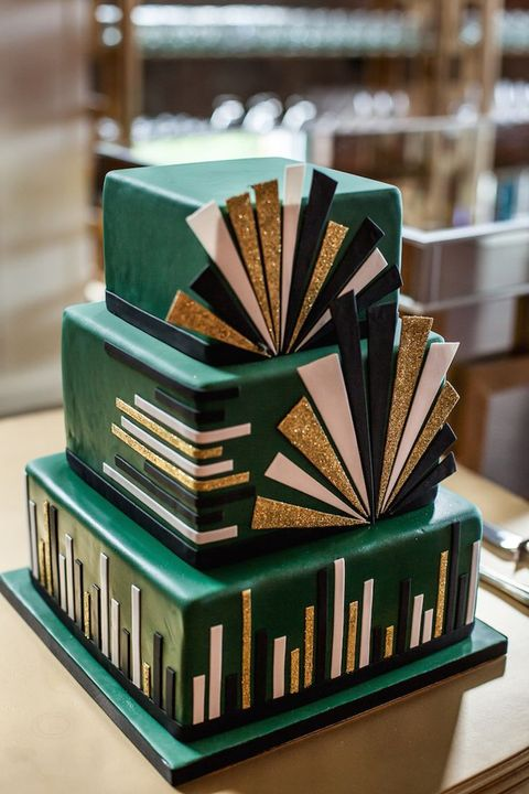 an emerald square wedding cake with black, white and gold glitter details