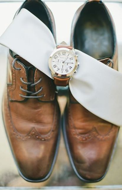 brown shoes and a chic watch on a matching leather bracelet for a polished look