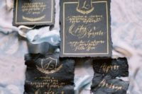 18 leather wedding invites with a raw edge and gold calligraphy
