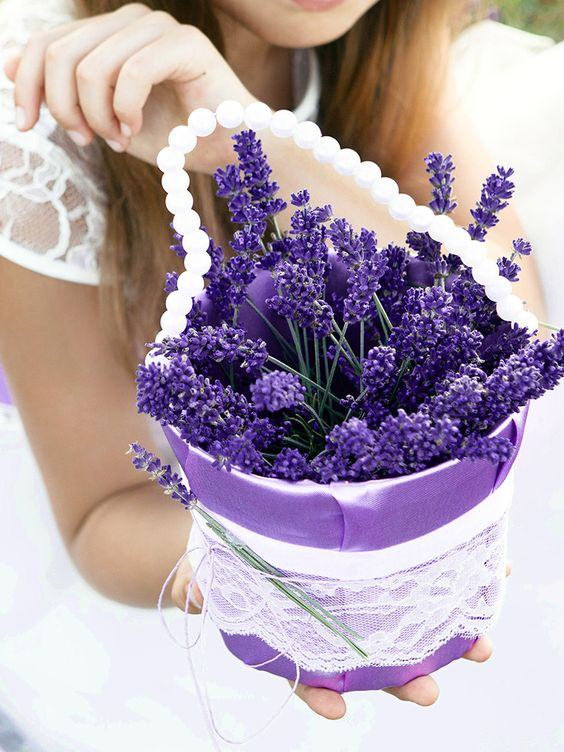 vintage flower girl basket with a pearl strand and filled with fresh lavender