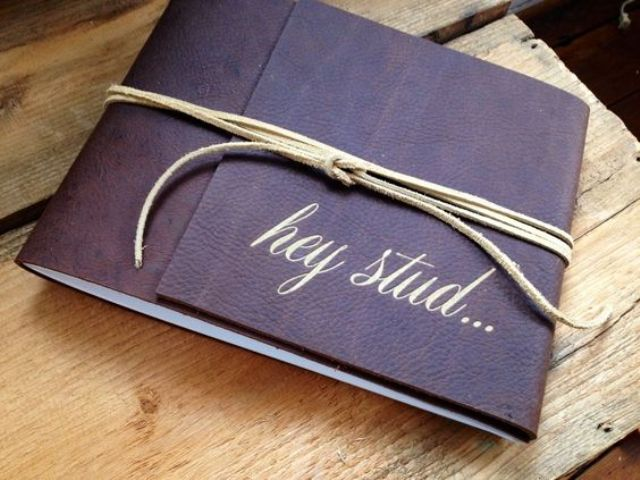 a chic leather album with a leather cord and calligraphy is a stylish and very hot gift