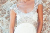 19 a deep scoop neckline wedding gown with a heavily embellished neckline and waistline, cap sleeves