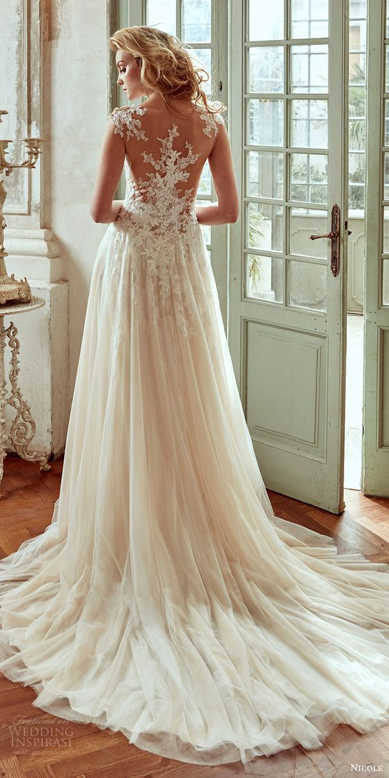 cap sleeve wedding dress with a lace applique illusion back and a flowy skirt