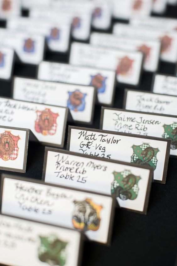 seating cards with symbols of Harry Potter colleges