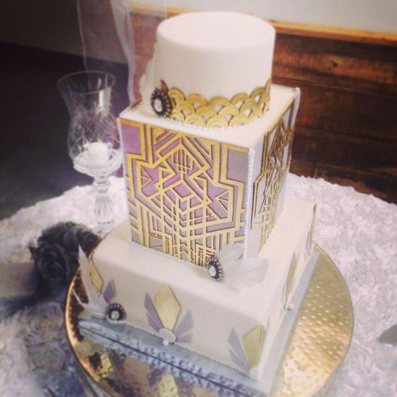 a chic cake with lilac and gold geo decor, scallops, vintage brooches