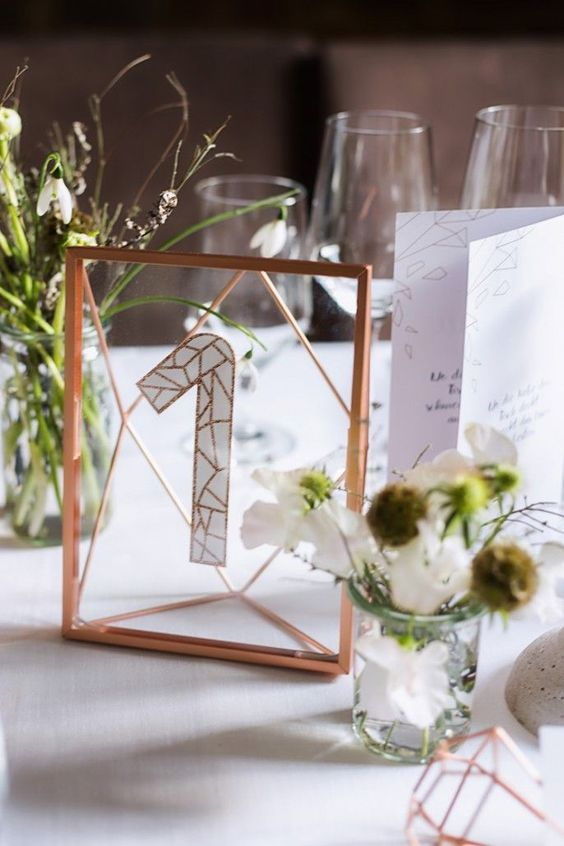 a glass copper number in framing and a glitter table number