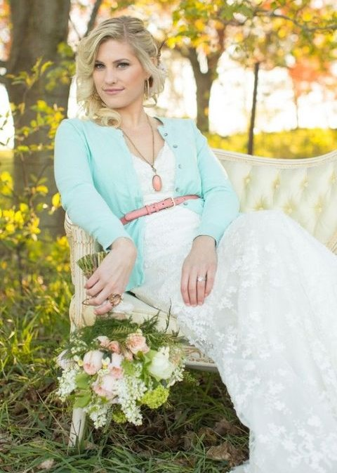 a mint cardigan with a pink leather belt for a chic and feminine bridal look