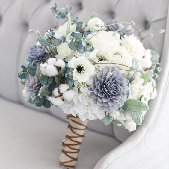 a pastel wedding bouquet in pale green, lavender and creamy shades