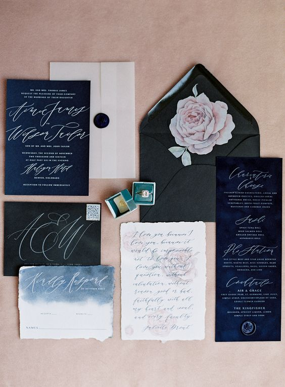 black, navy wedding stationery with watercolor blue touches and white calligraphy