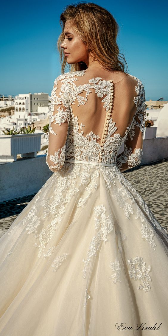 champagne lace ballgown with an illusion lace back on neutral buttons