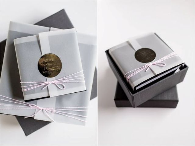 mini boudoir album with a hand embossed monogram label and pink twine