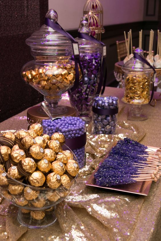 a gorgeous candy bar done in purple and gold, looks wow