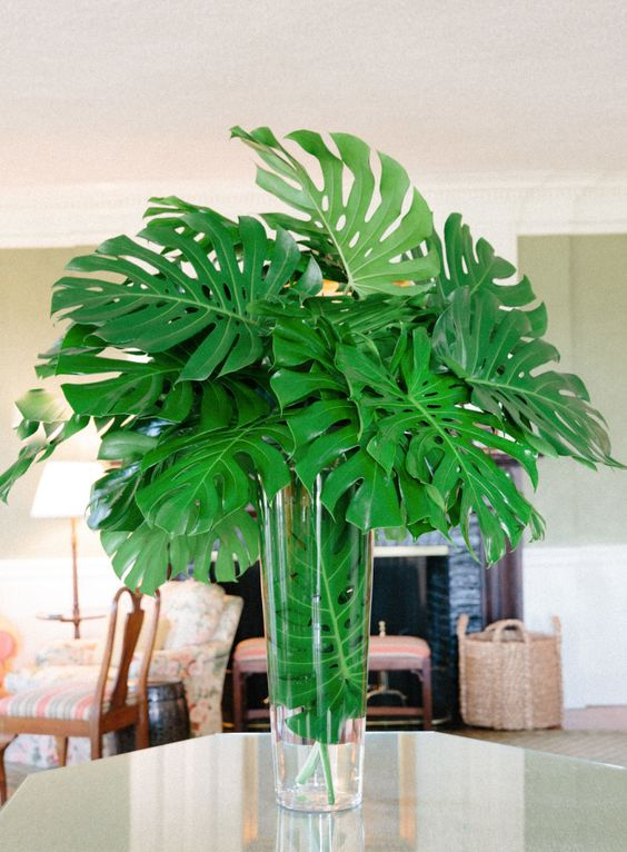 a lush tropical leaf wedding centerpiece is a chic idea for any tropical wedding