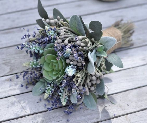a rustic weddign bouquet with succulents, pale greenery and lavender