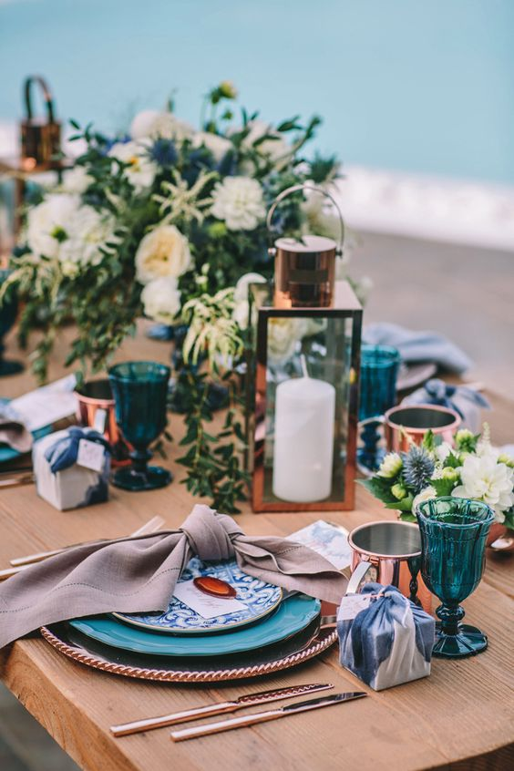 accentuate your table with indigo glasses, plates and gift boxes and add copper for a chic look