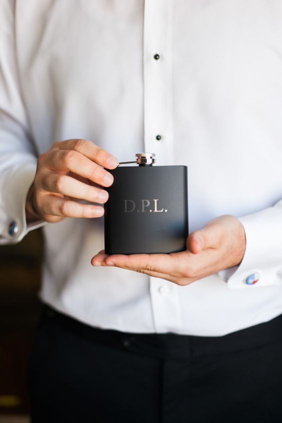 a matte black flask with his initials is a stylish and chic piece