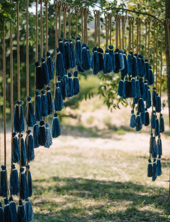 an indigo tassel wedding backdrop for a boho wedding