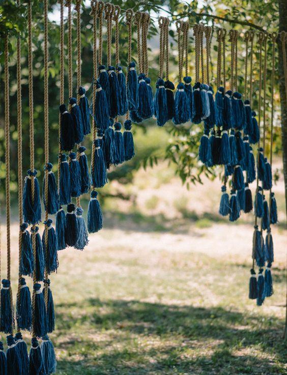 an indigo tassel wedding backdrop for a boho wedding