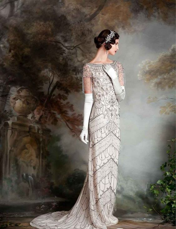 a scoop wedding dress, with short fringed sleeves and dark beading