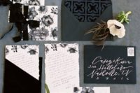 23 black and white wedding stationery with floral prints and black ribbon bows for a classic or organic wedding