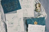 23 indigo envelopes with white invites and calligraphy, gold seals for a chic touch