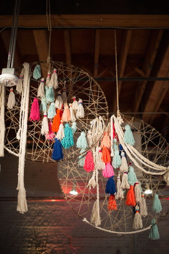 oversized dream catchers with colorful tassels for a cool rustic wedding
