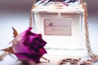 25 Miss Dior perfume with a vintage key and a rose to make it more special