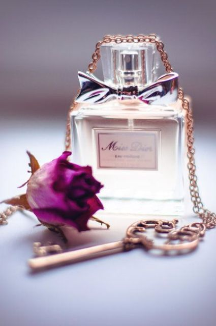 Miss Dior perfume with a vintage key and a rose to make it more special