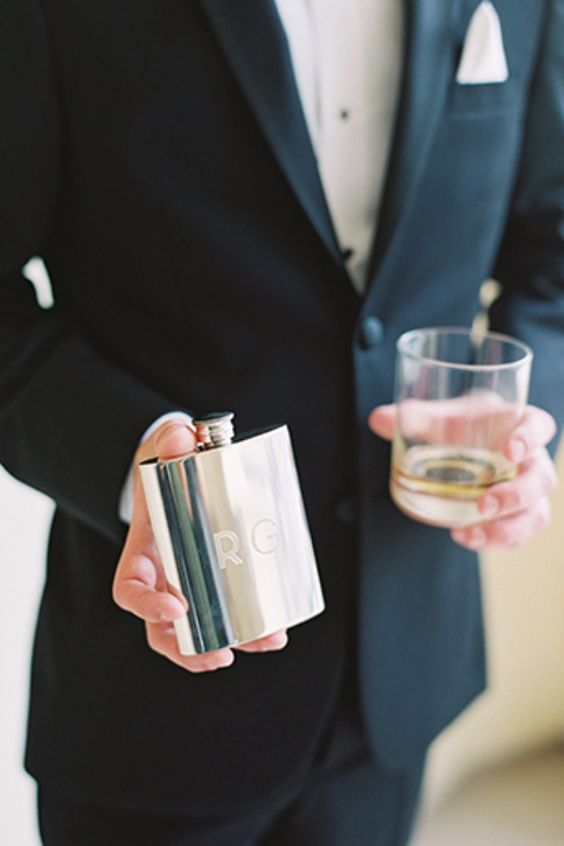 a neutral flask with initials is a cool idea for any groom