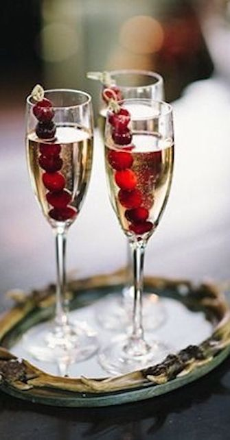 champagne with cranberries can be a signature cocktail for your wedding