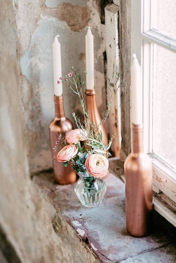 copper bottles as candle holders will add glam to any tablescape
