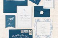 25 indigo wedding envelopes with white calligraphy and neutral invitations