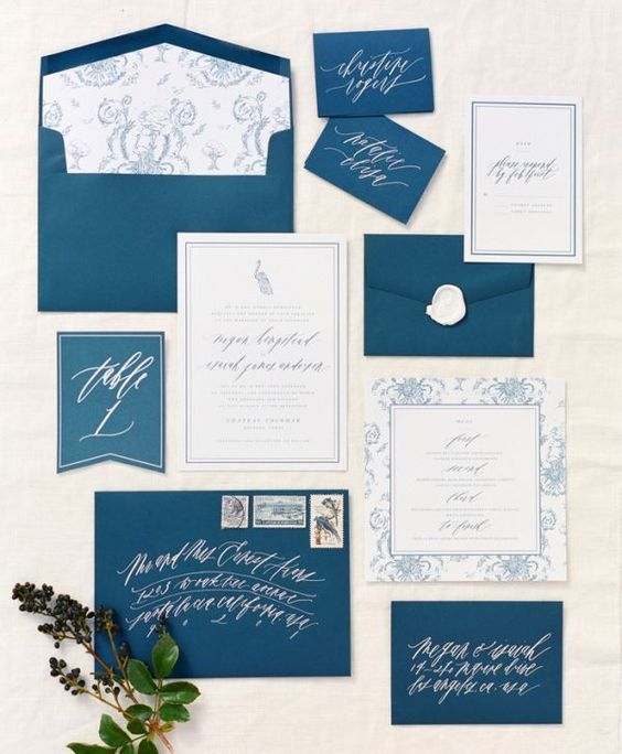 indigo wedding envelopes with white calligraphy and neutral invitations