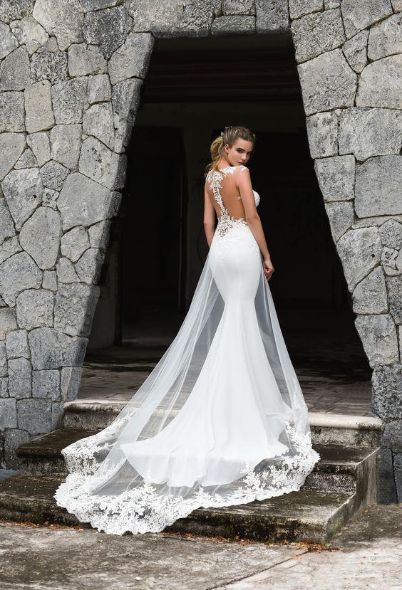 mermaid plain weddign gown with a lace bodice, an illusion racerback and a tulle and lace overskirt