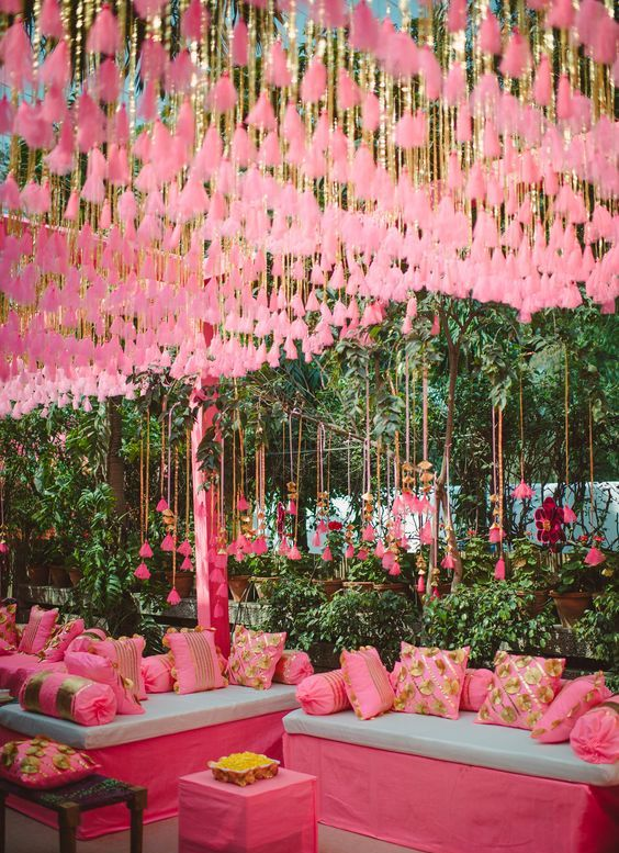 pink tassels hanging over the wedding reception is a fun and bold idea