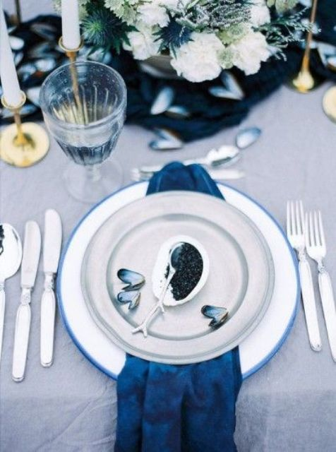 seaside place setting with an indog napkin and oysters