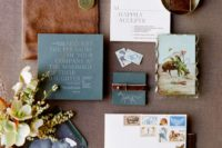 25 slate grey wedding invitations and brown leather envelopes for a chic moody feel yet not very dark