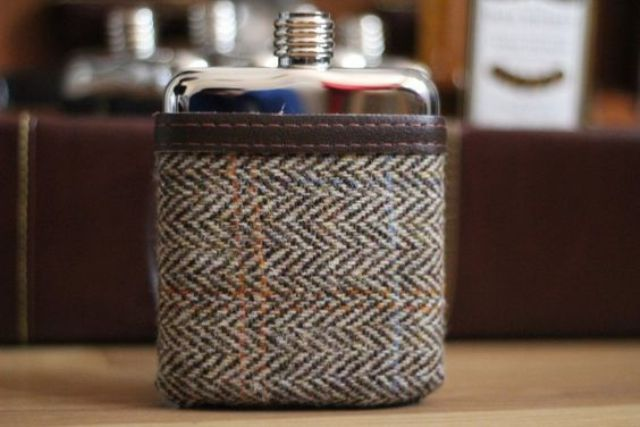 a swig flask covered in tweet pouch