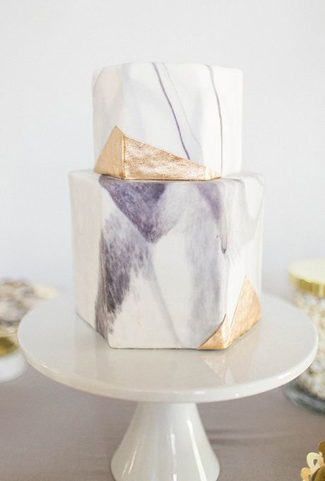a watercolor purple wedding cake with gold touches and of a geometric shape
